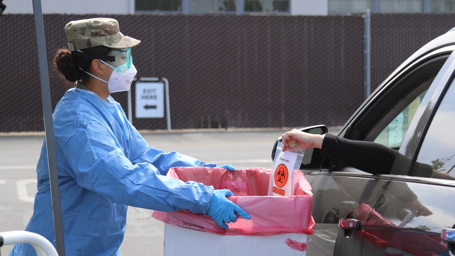 U.S. Army Pfc. Cynthia Veliz of the California Army National Guard collects a COVID-19 test specimen at a drive-thru assessment site in Long Beach, California, April 27, 2020.