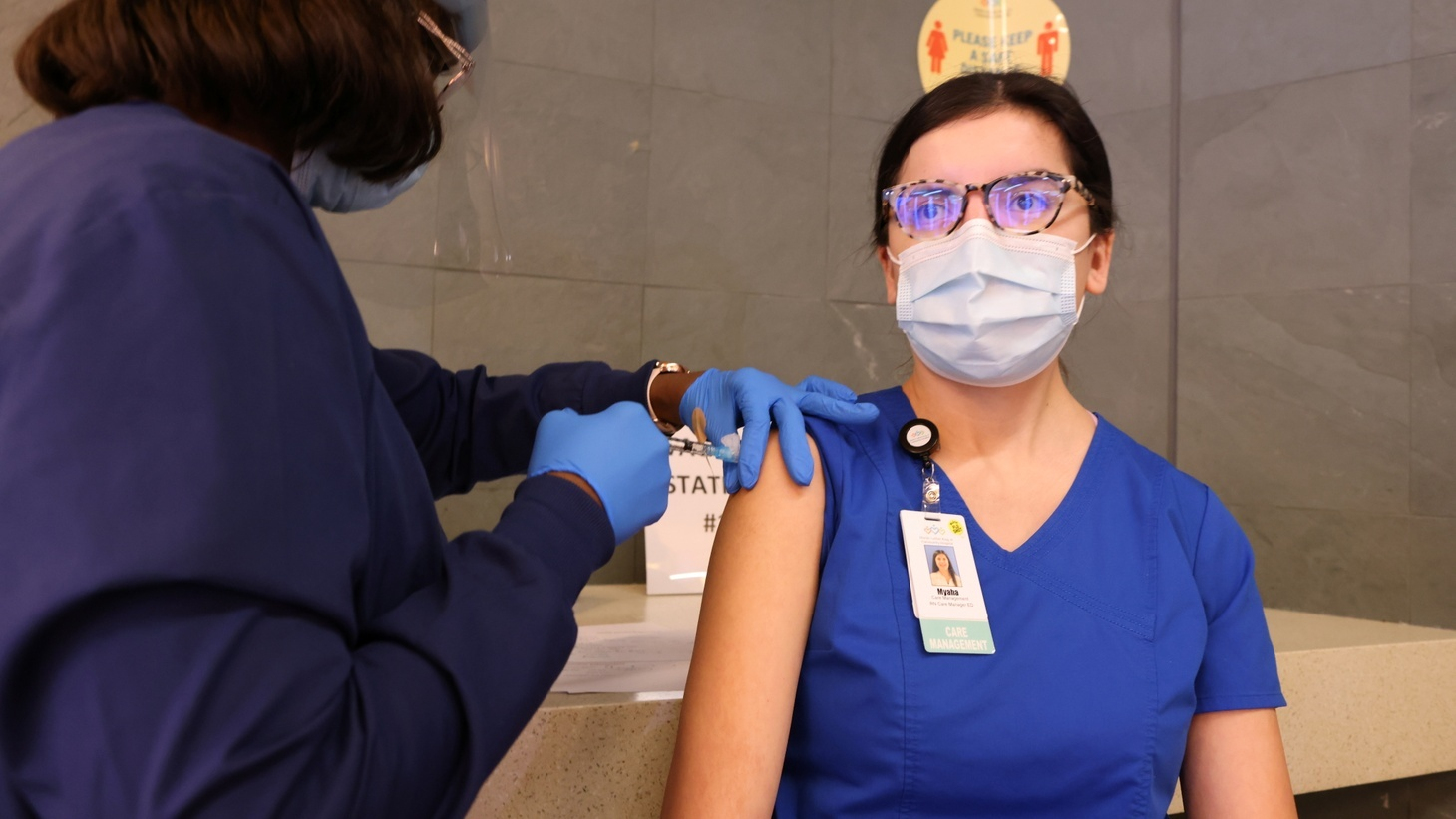 ER case manager Myaha Tovar, 24, is given the coronavirus disease (COVID-19) vaccine at Martin Luther King Jr. Community Hospital in South Los Angeles, California, U.S., December 17, 2020.