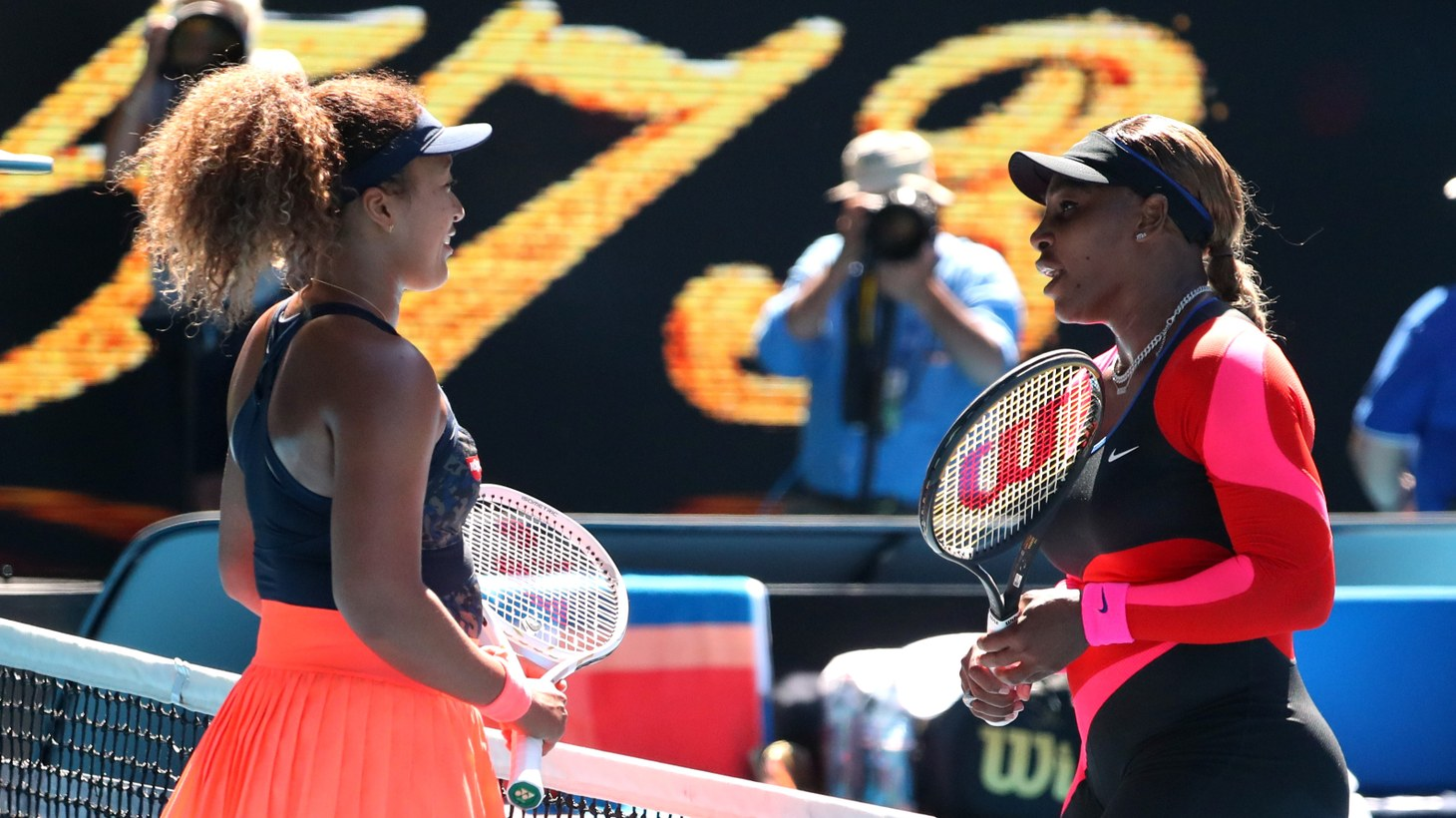 Japan's Naomi Osaka with Serena Williams of the U.S. after winning their semi final match at the Australian Open in Melbourne, Australia, February 18, 2021.