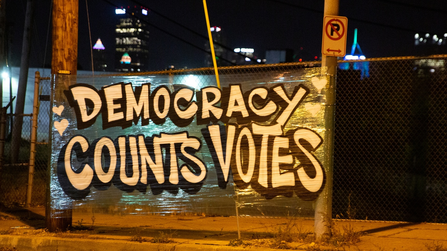 """A sign says """"democracy counts votes,"""" displayed near the Allegheny County Election Warehouse after the election in Pittsburgh, Pennsylvania, U.S. November 6, 2020."""