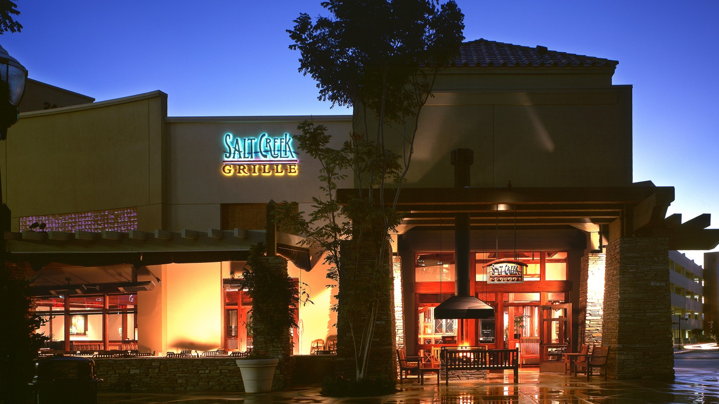 Salt Creek Grille in Valencia turned its large patio and outdoor waiting area into extra dining space. Now they won't be using it. Public health officials have suspended outdoor dining in LA County for the next three weeks, starting 10 p.m. this Wednesday.