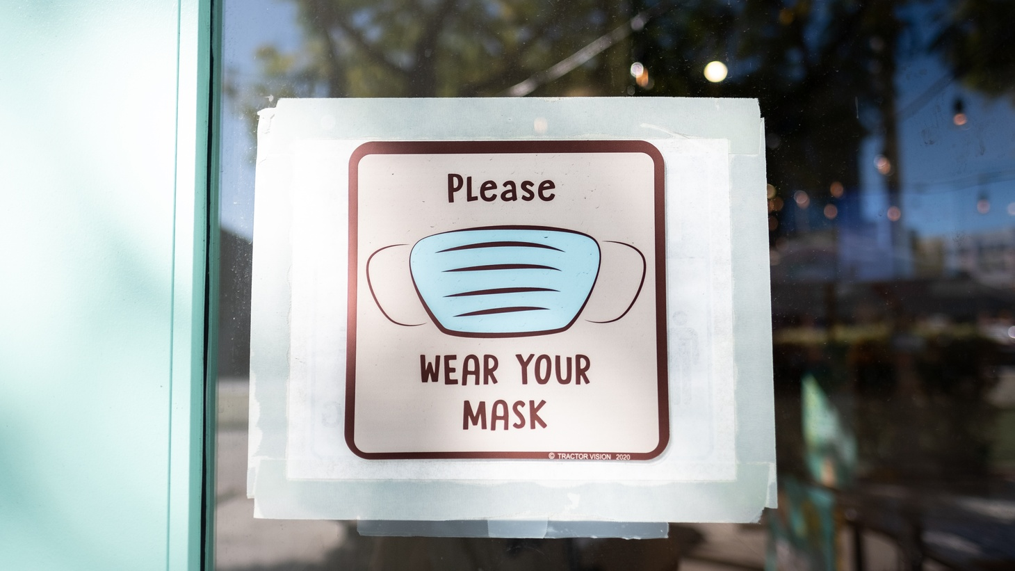 A front door sign at a business in Culver City, California, reminds customers to wear their masks. January 21, 2021.