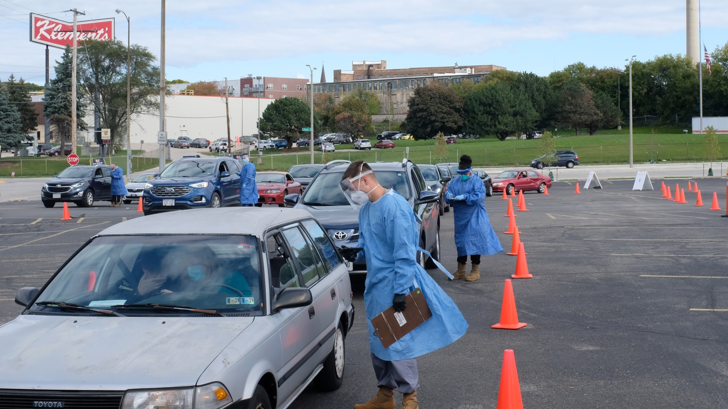 People line up in their vehicles to undergo the coronavirus disease (COVID-19) tests, distributed by the Wisconsin National Guard at the United Migrant Opportunity Services center, as cases spread in the Midwest, in Milwaukee, Wisconsin, U.S., October 2, 2020.