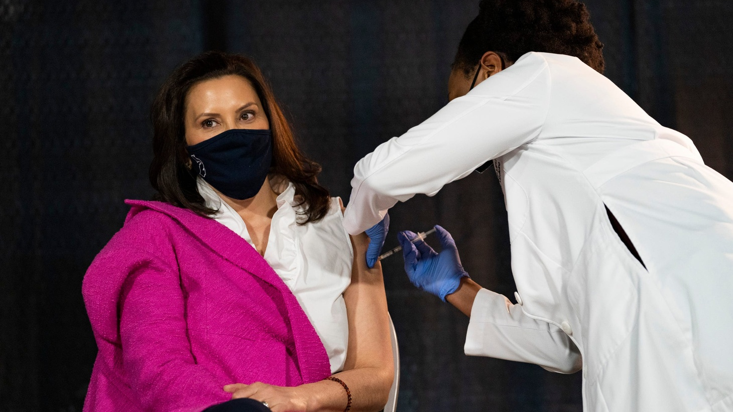 Governor Gretchen Whitmer, in an attempt to encourage young adults, gets her first COVID-19 vaccine Tuesday, Apr. 6, 2021 at Ford Field, administered by Michigan Chief Medical Executive Dr. Joneigh S. Khaldun.
