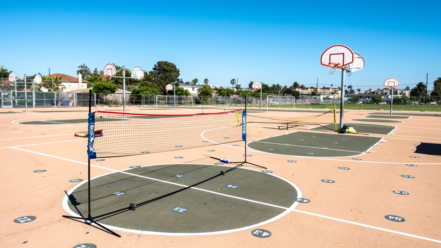 Badminton and basketball courts stay empty at Palms Middle School, Los Angeles.