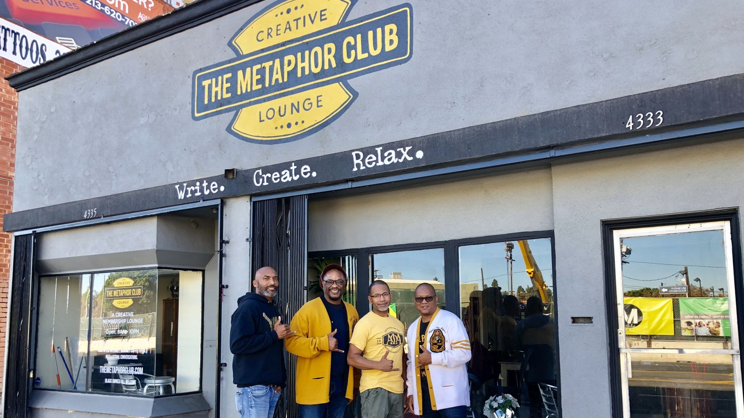 Lawrence Ross (second from the left) stands with fellow co-founders of the Metaphor Club, a co-working space in Leimert Park. He says business was thriving before COVID-19.