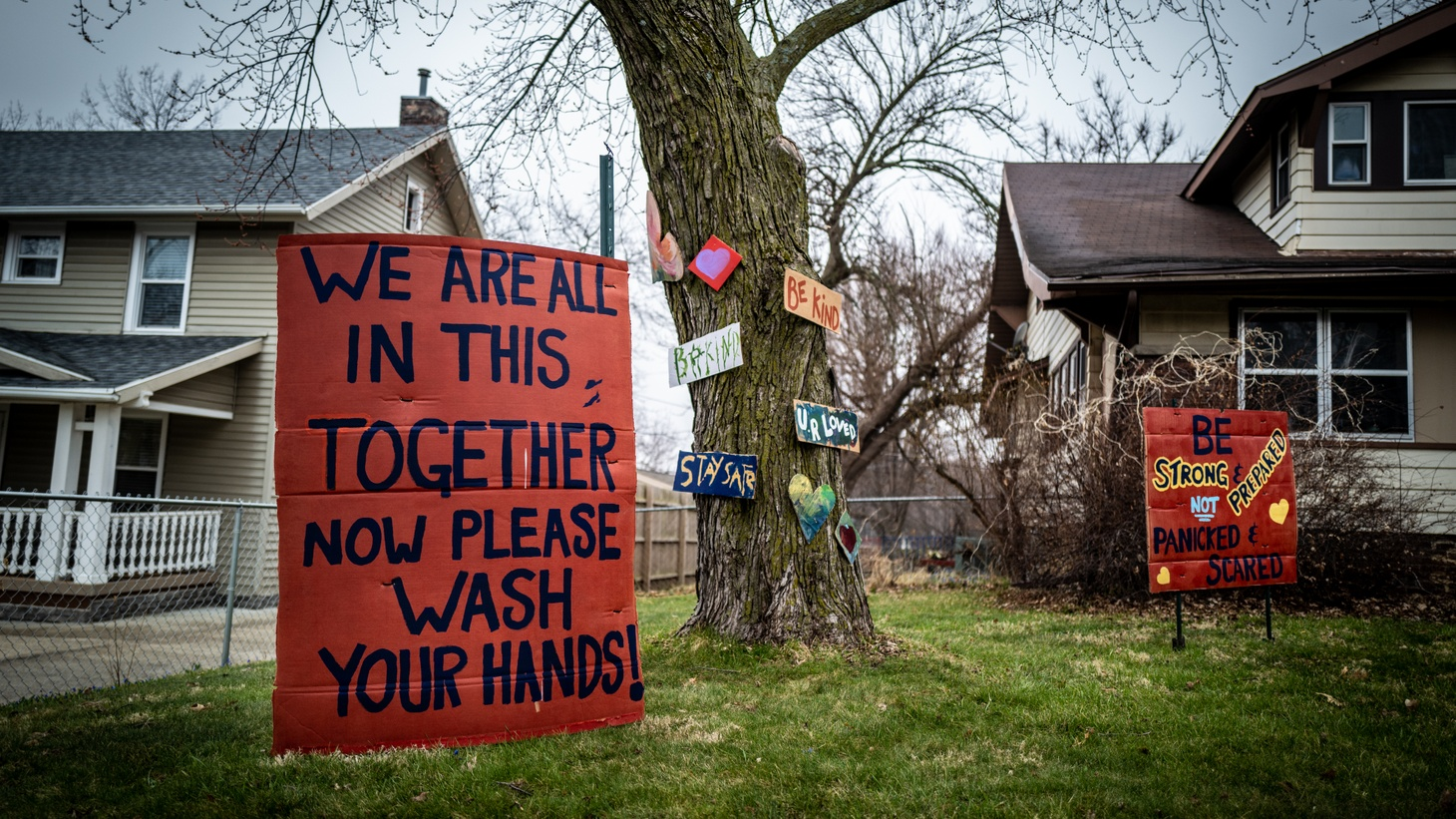 Lawn signs offer inspiration while reminding residents to wash their hands — outside a house in Des Moines. Iowa is one state that's seeing a spike in COVID-19 cases.