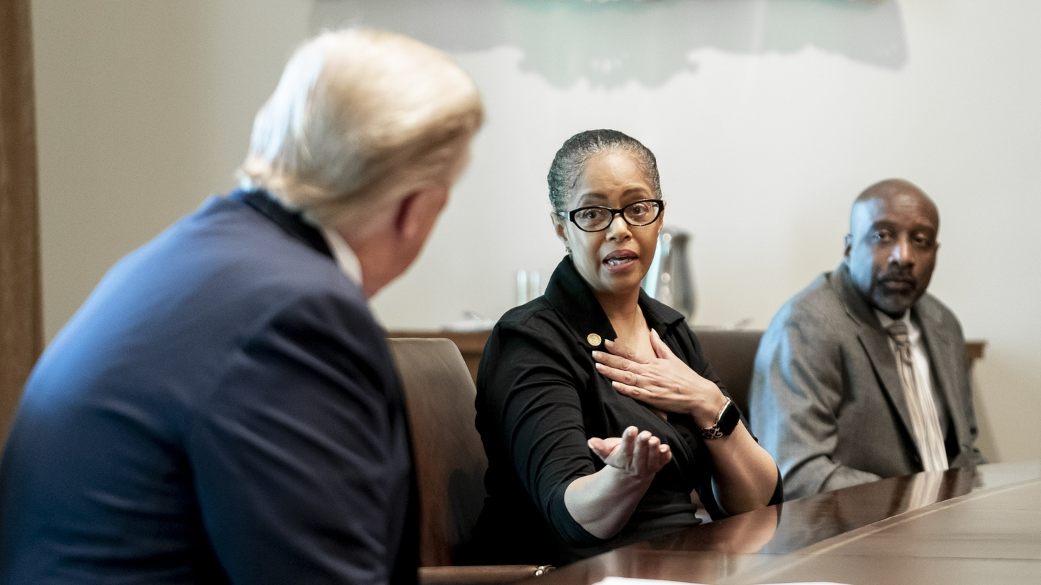 President Donald J. Trump listens as Michigan State Rep. Karen Whitsett talks about her recovery from the COVID-19 Coronavirus, Tuesday, April 14, 2020, in the Cabinet Room of the White House.