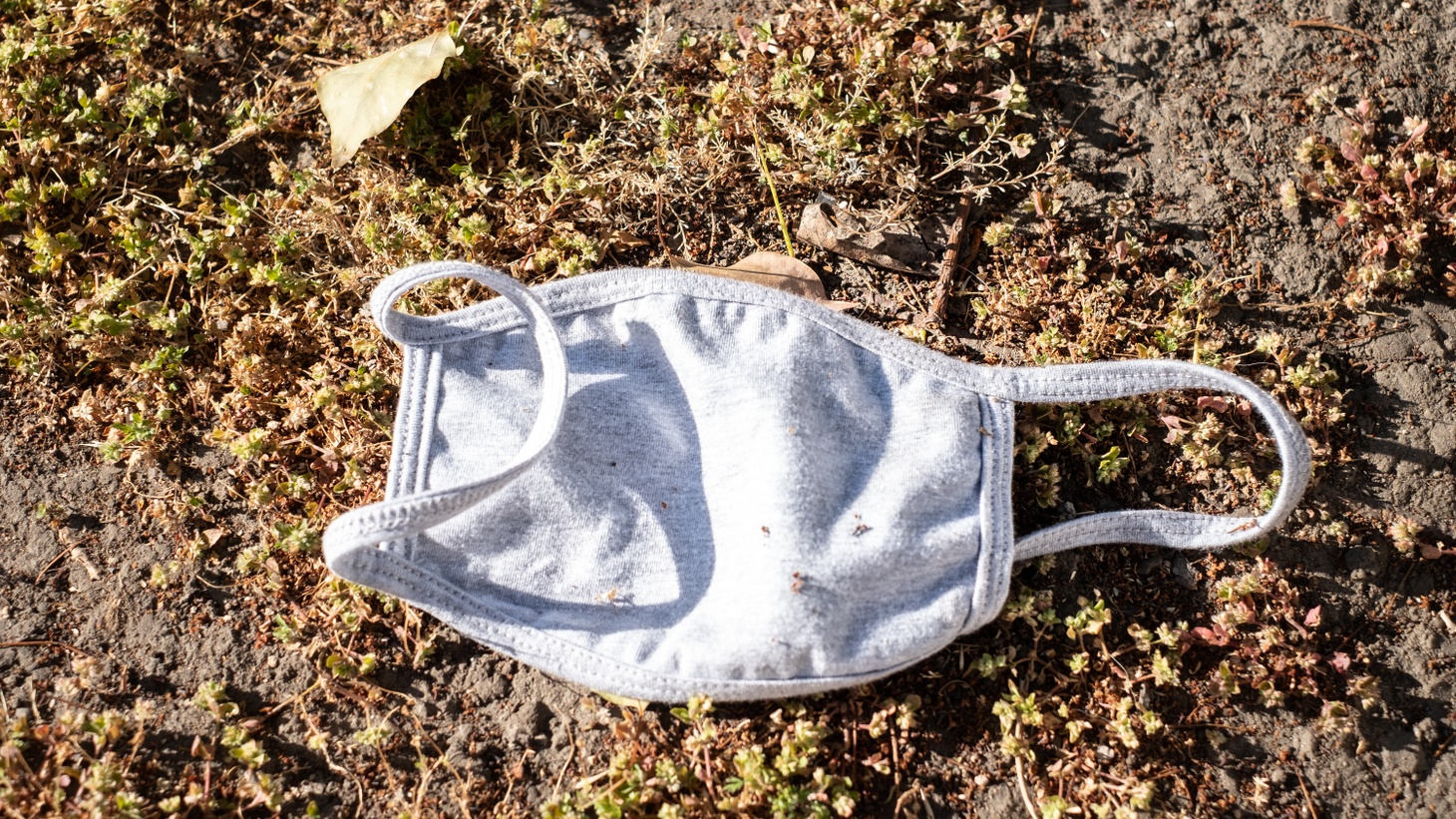 """A mask abandoned on the ground. Lancaster Mayor R. Rex Parris says, """"I now have 74 dead people [in Lancaster], and I think that could have been substantially less. What they [LA County Department of Public Health] failed to do very early, that everyone knew they should do, was have a mask ordinance that was enforced."""""""