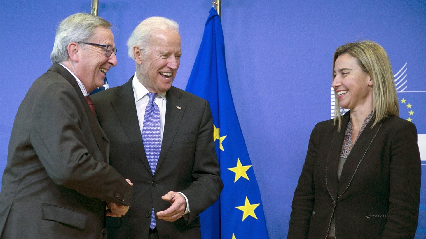 Feb. 6, 2015: European Commission President Jean-Claude Juncker (L) and European Union foreign policy chief Federica Mogherini (R) welcome U.S. Vice President Joe Biden at the EU Commission headquarters in Brussels. Biden said on Friday that the United States and Europe needed to stand together over Ukraine and accused Russian President Vladimir Putin of calling for peace while rolling his troops through Ukrainian countryside.
