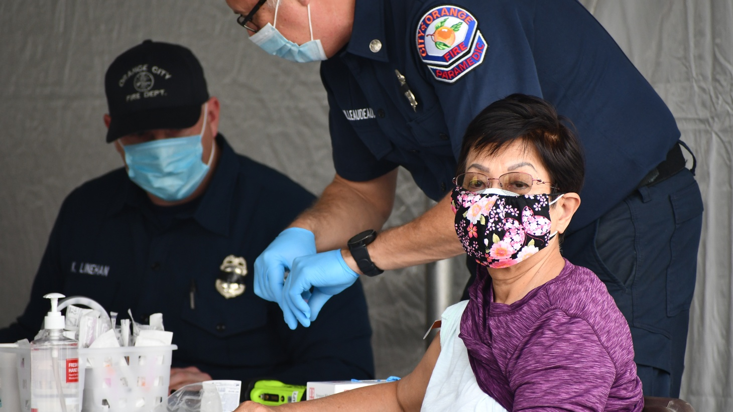 Orange County paramedics administer the coronavirus vaccine to residents at the Disneyland Resort vaccination site, January 13, 2021.