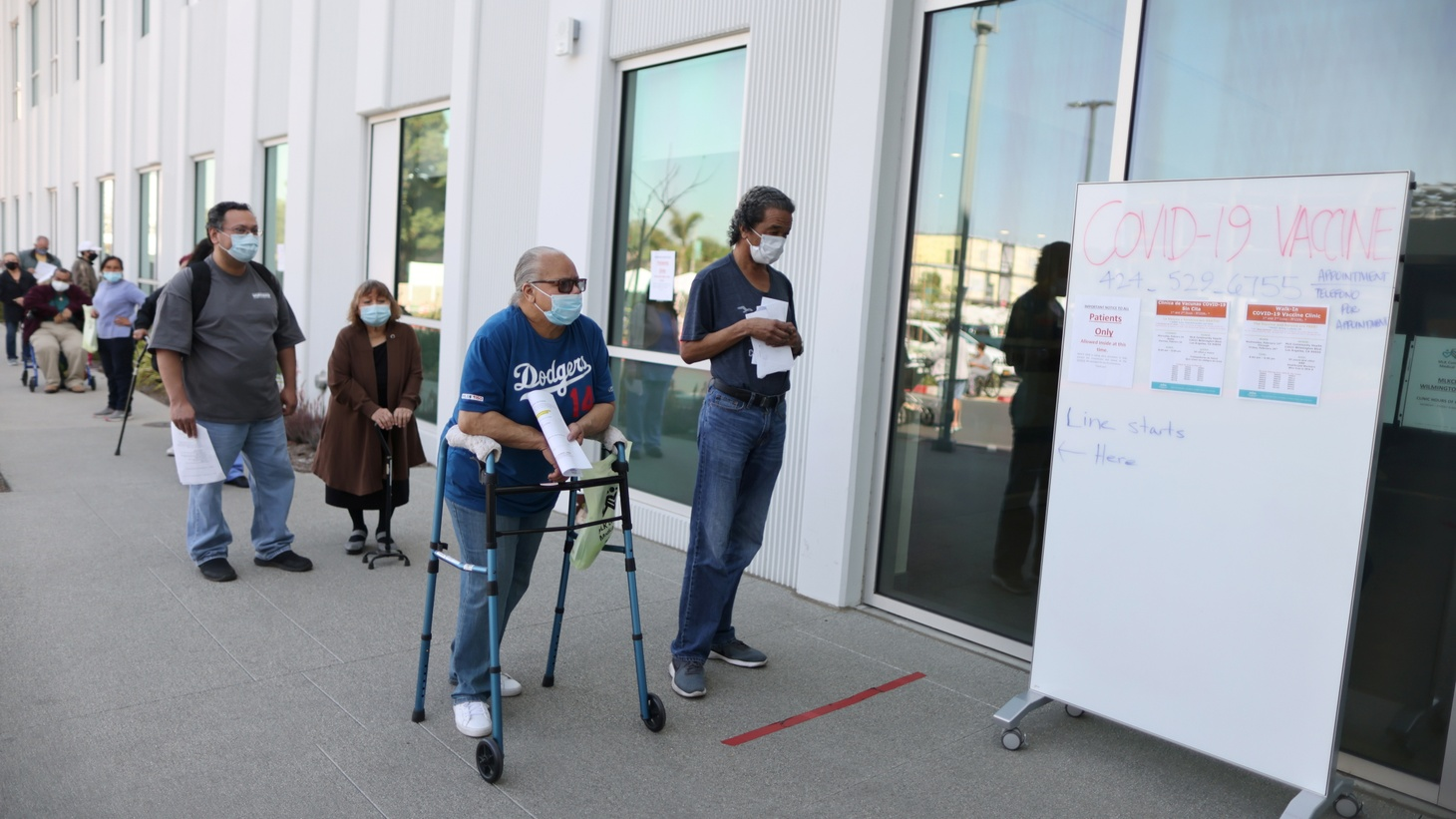 People wait in line for coronavirus disease (COVID-19) vaccinations at Martin Luther King Jr. Community Hospital in Willowbrook, Los Angeles, California, U.S., February 25, 2021.
