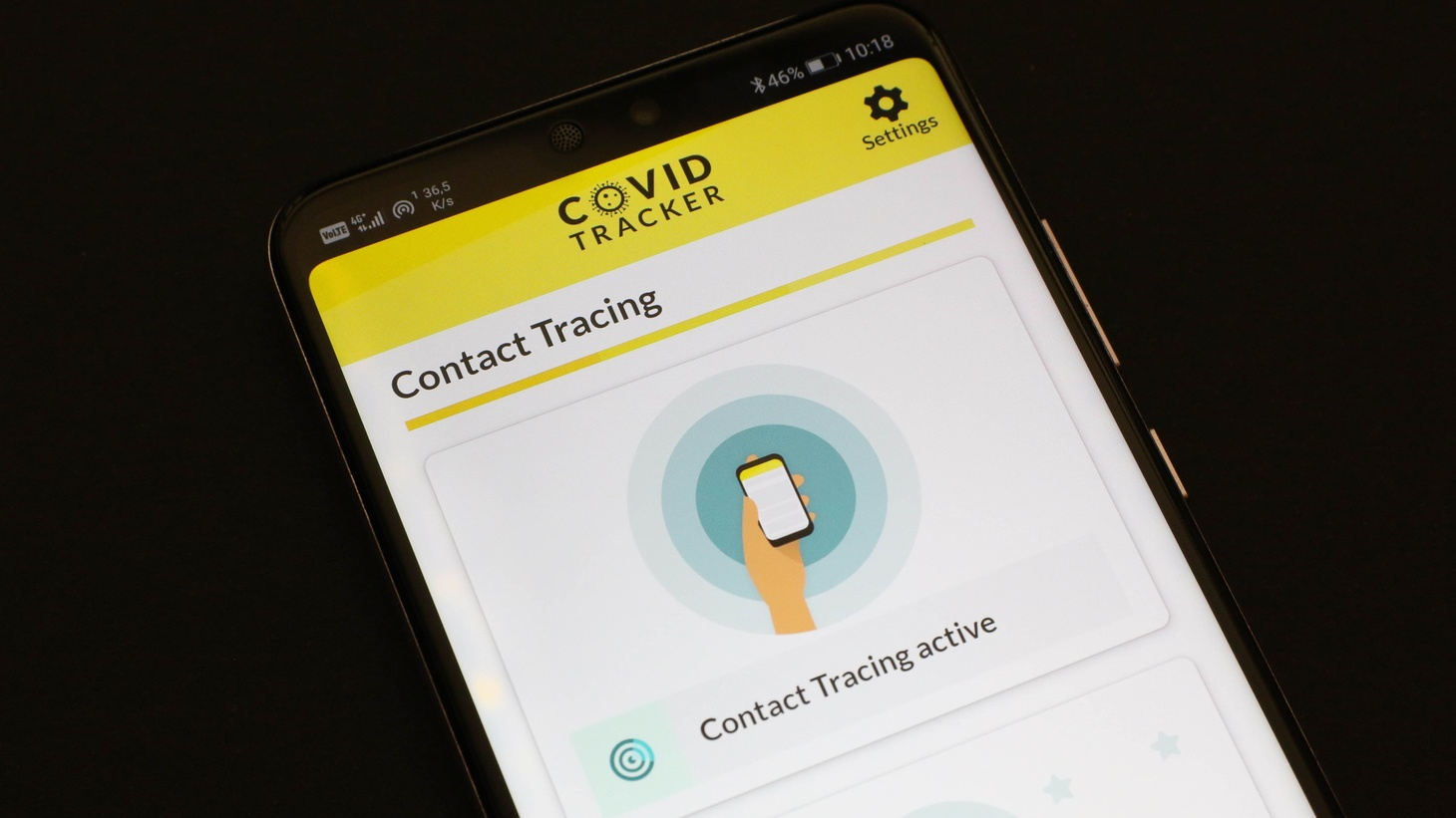 An Android smartphone is open with a COVID contact tracking app.