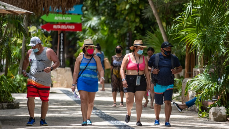 About half a million Americans went to Mexico in October — one-third less than a typical year. But Mexico is the only country where Americans are still vacationing.