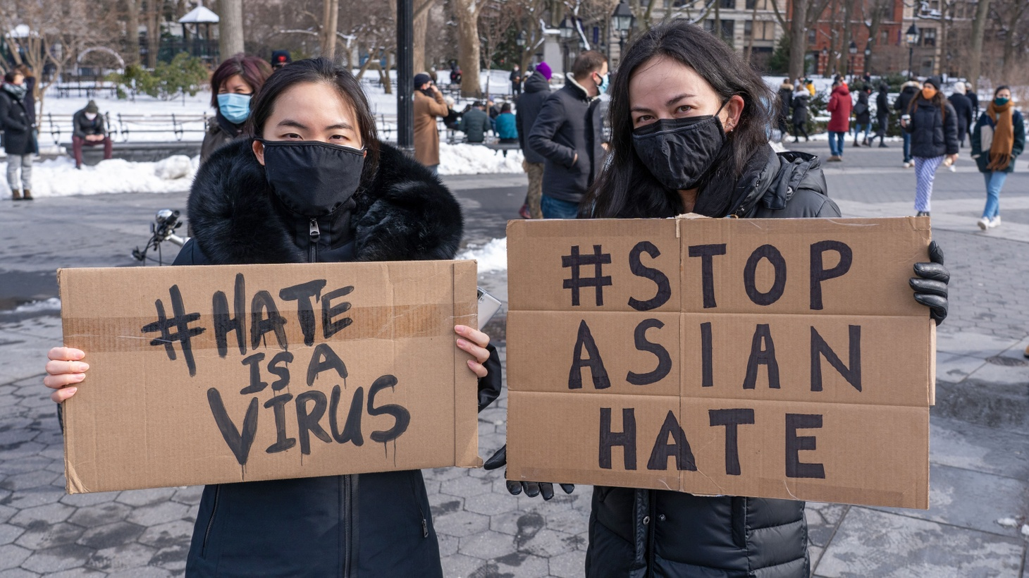 """Protestors hold placards that read """"hate is a virus"""" and """"stop Asian hate"""" during End The Violence Towards Asians rally in Washington Square Park. Since the start of the coronavirus pandemic, violence towards Asian Americans has increased at a much higher rate than previous years. The New York City Police Department (NYPD) reported a 1,900% increase in anti-Asian hate crimes in 2020."""