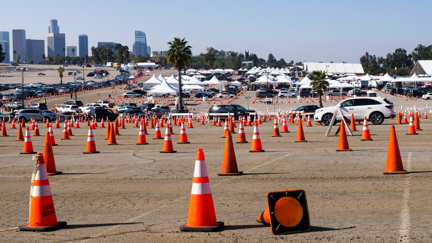 Drivers line up for coronavirus vaccination shots at Dodger Stadium in LA, March 13, 2021.