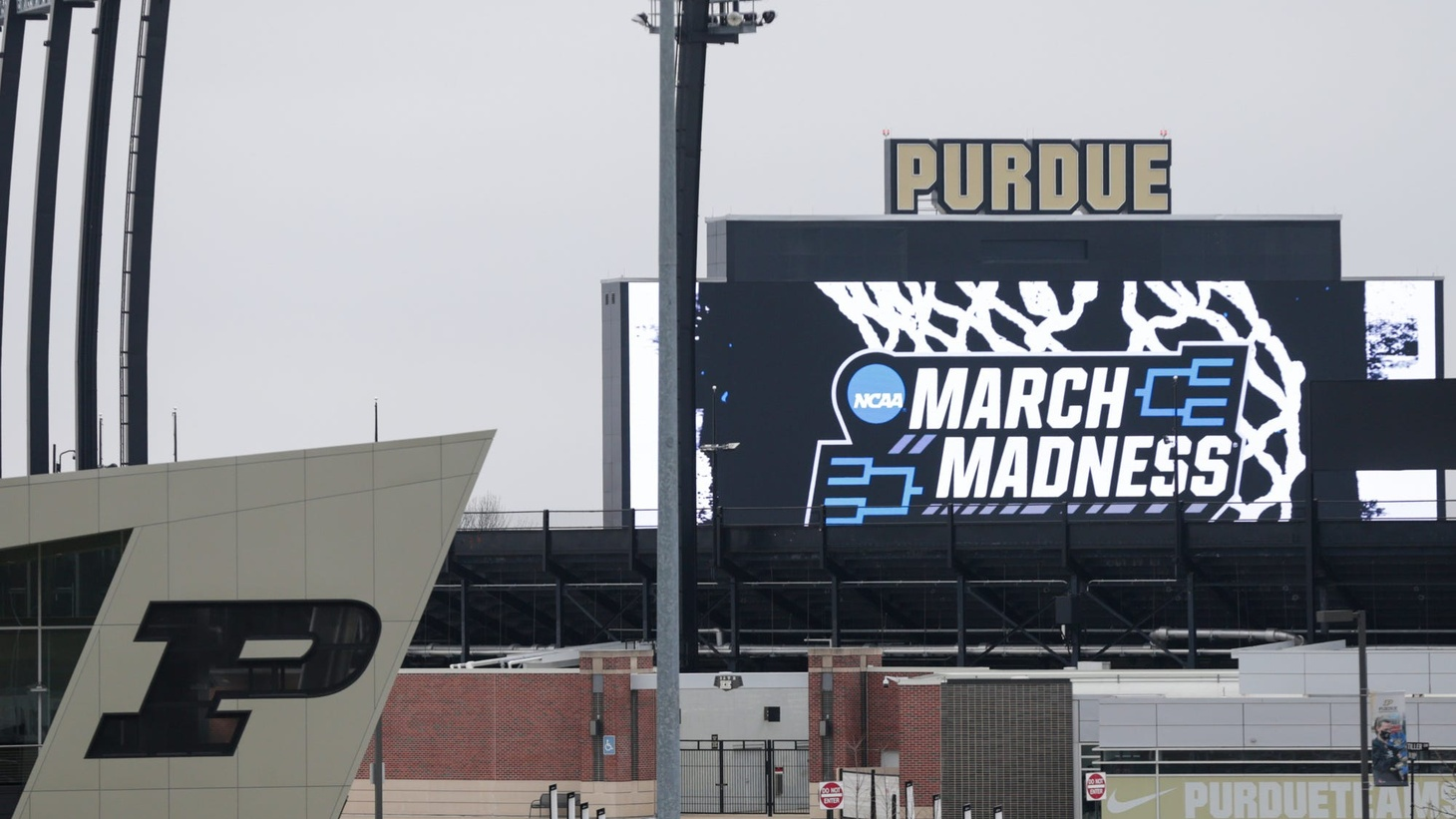 The NCAA March Madness logo is displayed on the Ross-Ade Stadium video board ahead of the 2021 NCAA Men's Basketball Tournament games at Mackey Arena, Tuesday, March 16, 2021 in West Lafayette.