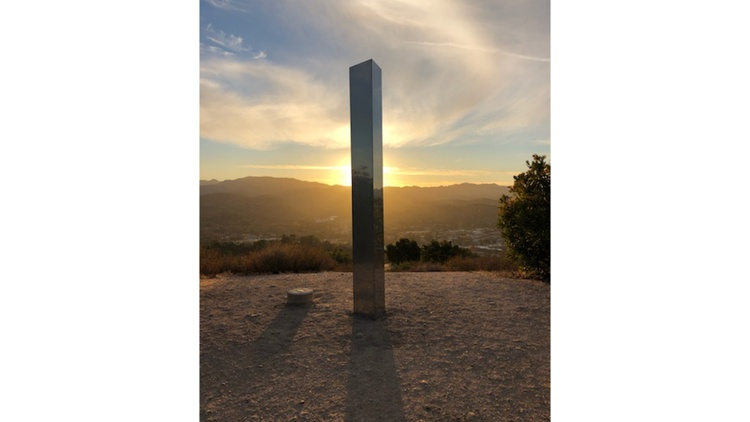 Travis Kenney, Wade Mckenzie, and Jared Riddle are behind two monoliths in Atascadero, California.