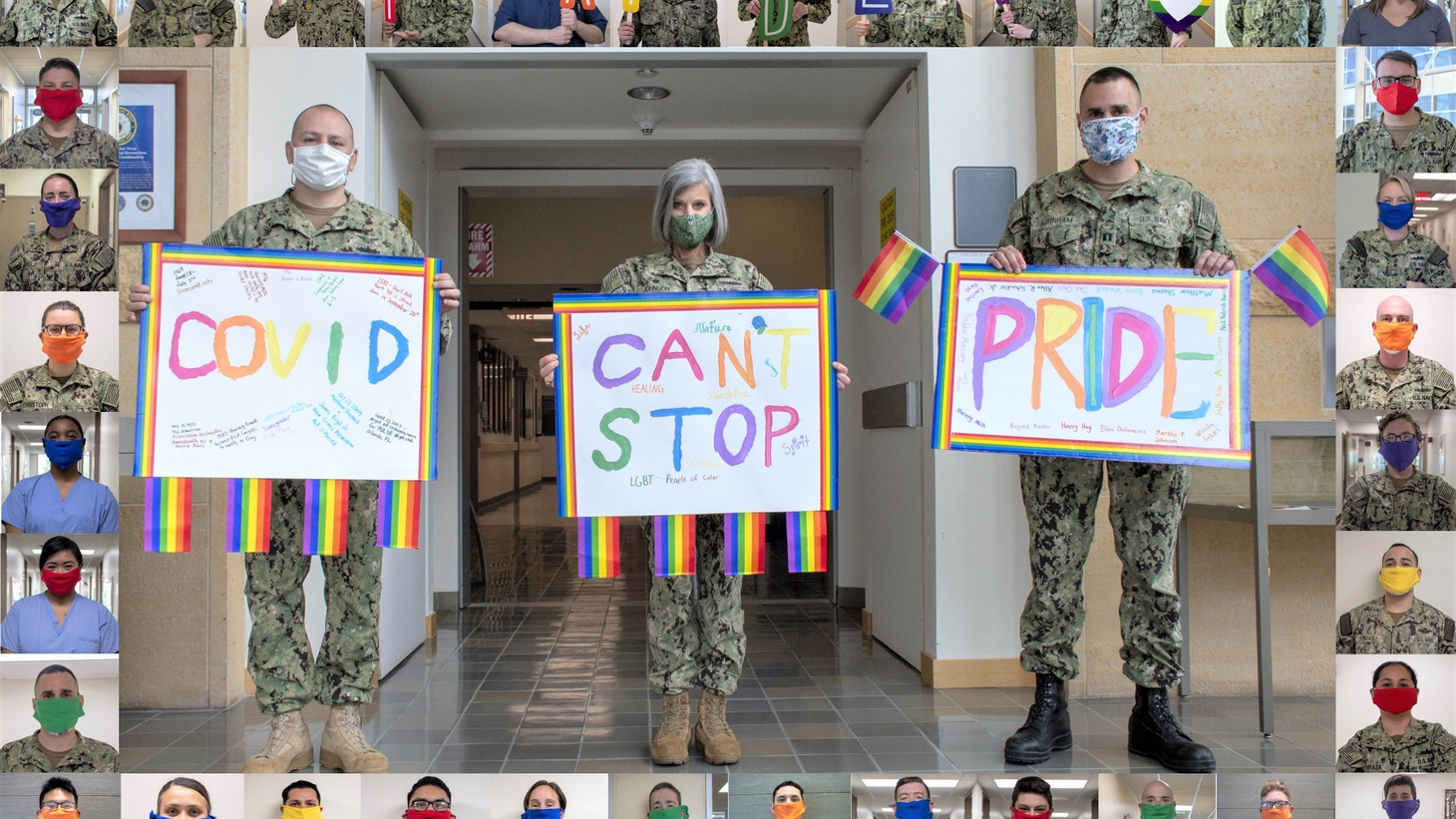 """U.S. military members hold a three-part sign that says """"COVID can't stop pride."""""""