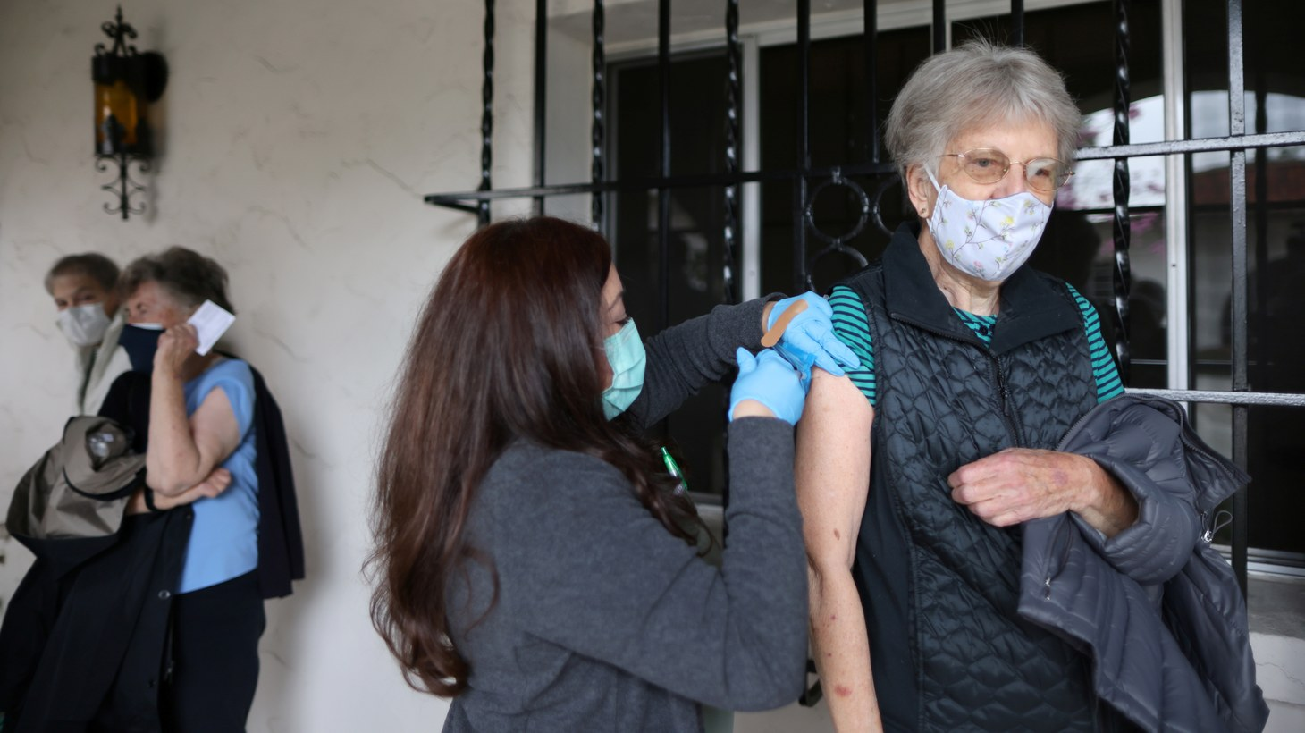 Sister Linda Snow, 80, receives a coronavirus disease (COVID-19) vaccine at a vaccination drive for retired nuns at the Sisters of St. Joseph of Carondelet independent living center in Los Angeles, California, U.S., March 3, 2021.