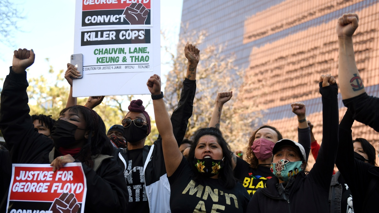Demonstrators assemble behind the Hennepin County Government Center in downtown Minneapolis, Minnesota, U.S. March 8, 2021. The trial of Derek Chauvin, the former Minneapolis police officer accused of killing George Floyd, starts this week.