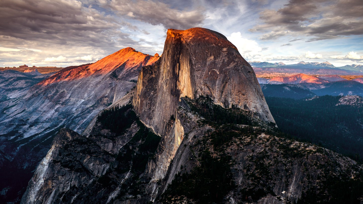 Half Dome is a distinctly shaped granite rock formation in Yosemite National Park.