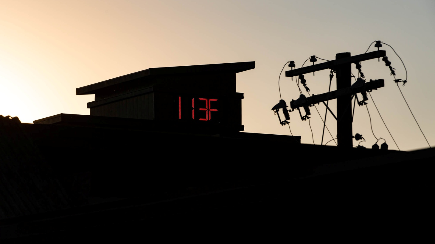 A thermometer reads 113 degrees Fahrenheit during a heat wave in Portland, Oregon, U.S. June 27, 2021.