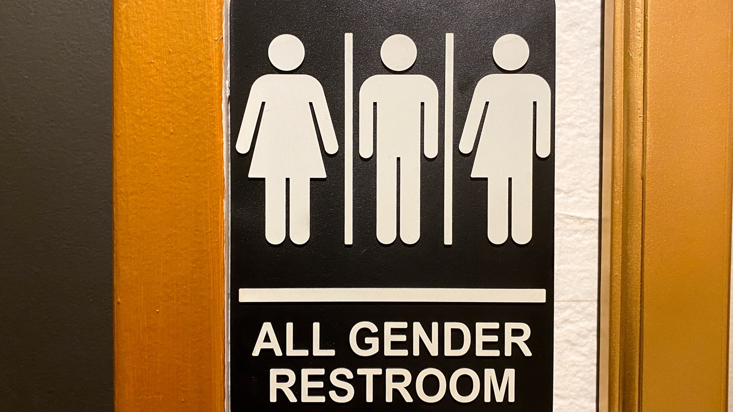A sign for an all-gender restroom is seen.