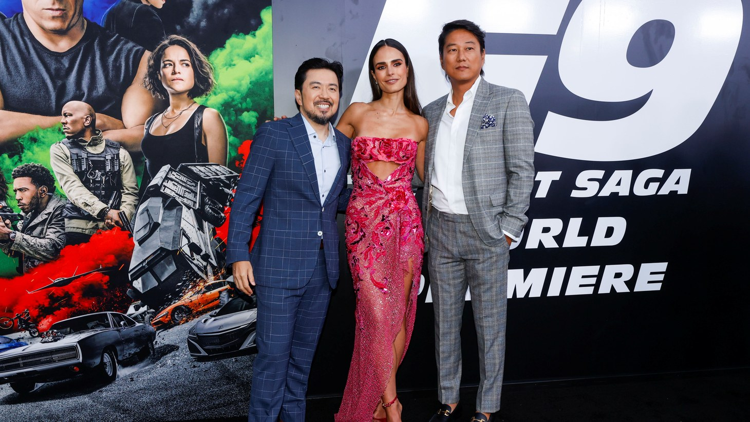 """Cast members Jordana Brewster and Sung Kang pose with director Justin Lin as they attend the world premiere of the movie """"F9: The Fast Saga"""" at TCL Chinese Theatre in Los Angeles, California, U.S., June 18, 2021."""