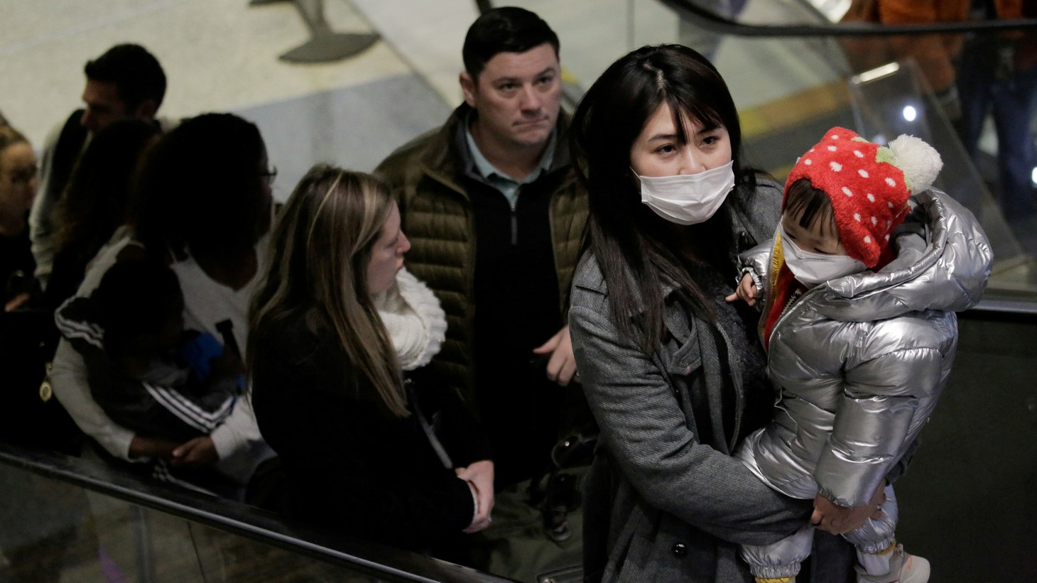 Travellers wearing masks arrive on a direct flight from China, after a spokesman from the U.S. Centers for Disease Control and Prevention (CDC) said a traveller from China had been the first person in the United States to be diagnosed with the Wuhan coronavirus, at Seattle-Tacoma International Airport in SeaTac, Washington, U.S. January 23, 2020.