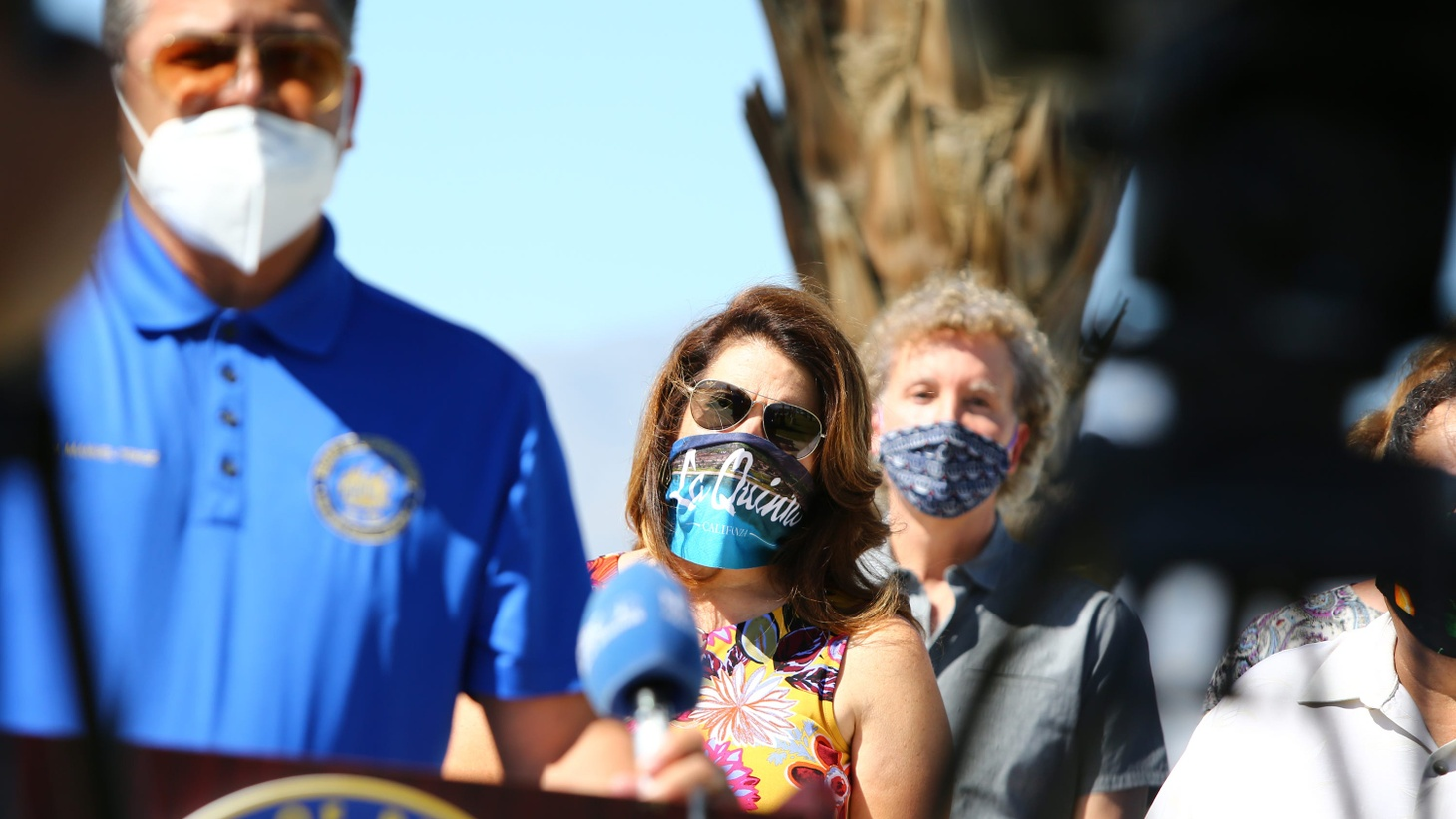 Riverside County Supervisor V. Manuel Perez, left, City of La Quinta Mayor Linda Evans, and City of Palm Springs Mayor Geoff Kors were tested for coronavirus at the Riverside County Fairgrounds in Indio, Calif., on May 27, 2020. It was part of a campaign to encourage the public to be tested.