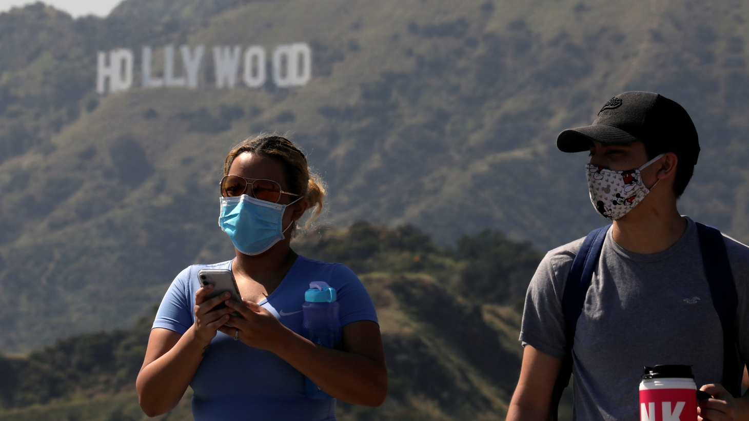 People wearing face masks hike past the Hollywood sign in Griffith Park on May 10.