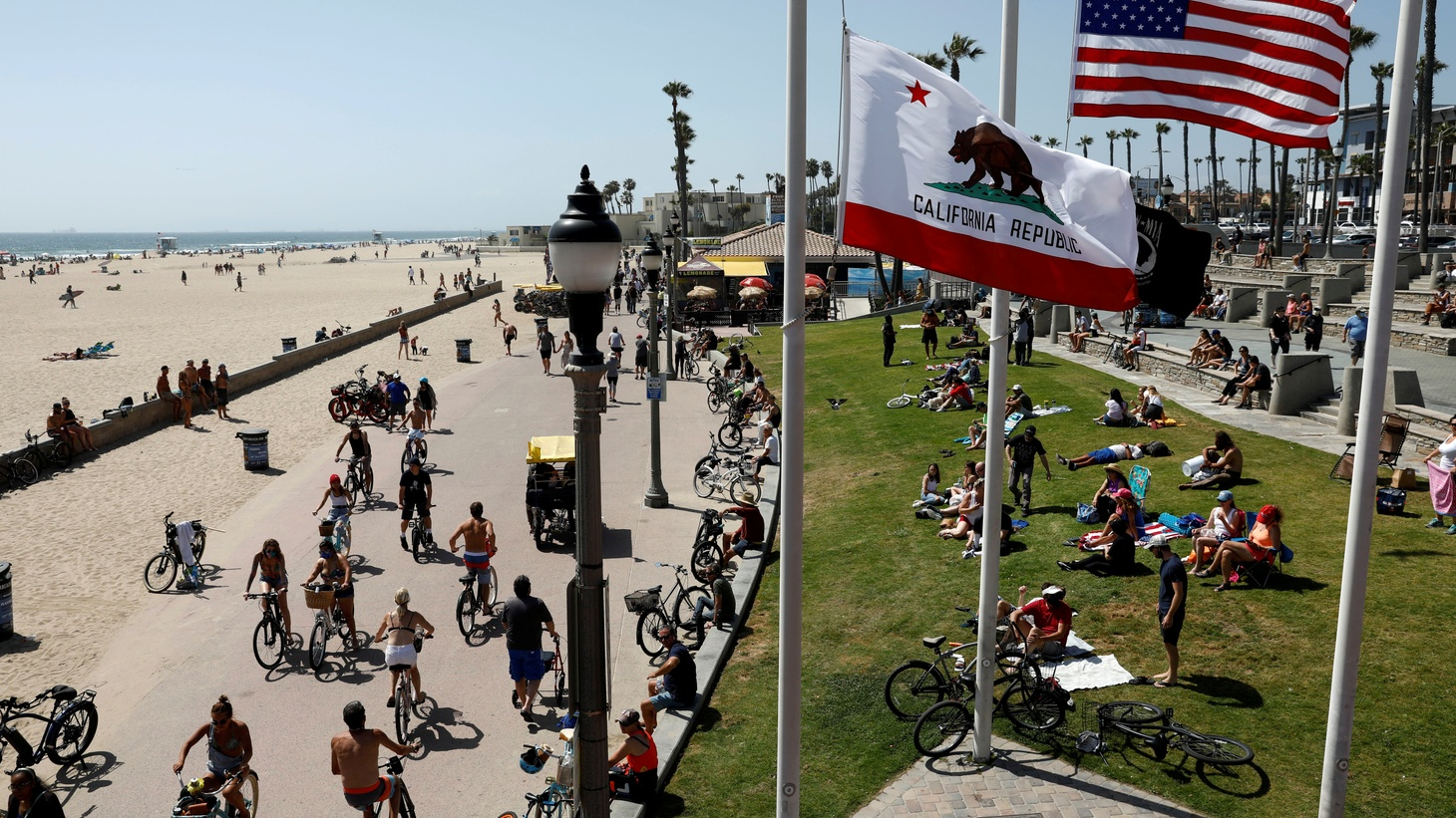 People spend Memorial Day weekend at the beach during the coronavirus disease pandemic in Huntington Beach, California, U.S., May 23, 2020.