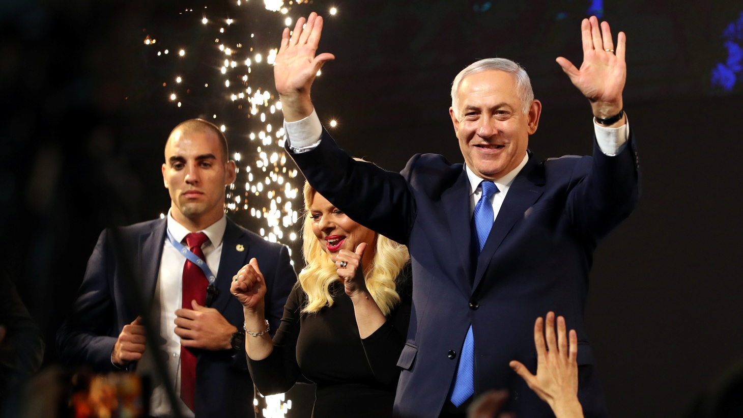 Israeli Prime Minister Benjamin Netanyahu and his wife Sara react as they stand on stage following the announcement of exit polls in Israel's parliamentary election at the party headquarters in Tel Aviv, Israel April 10, 2019.
