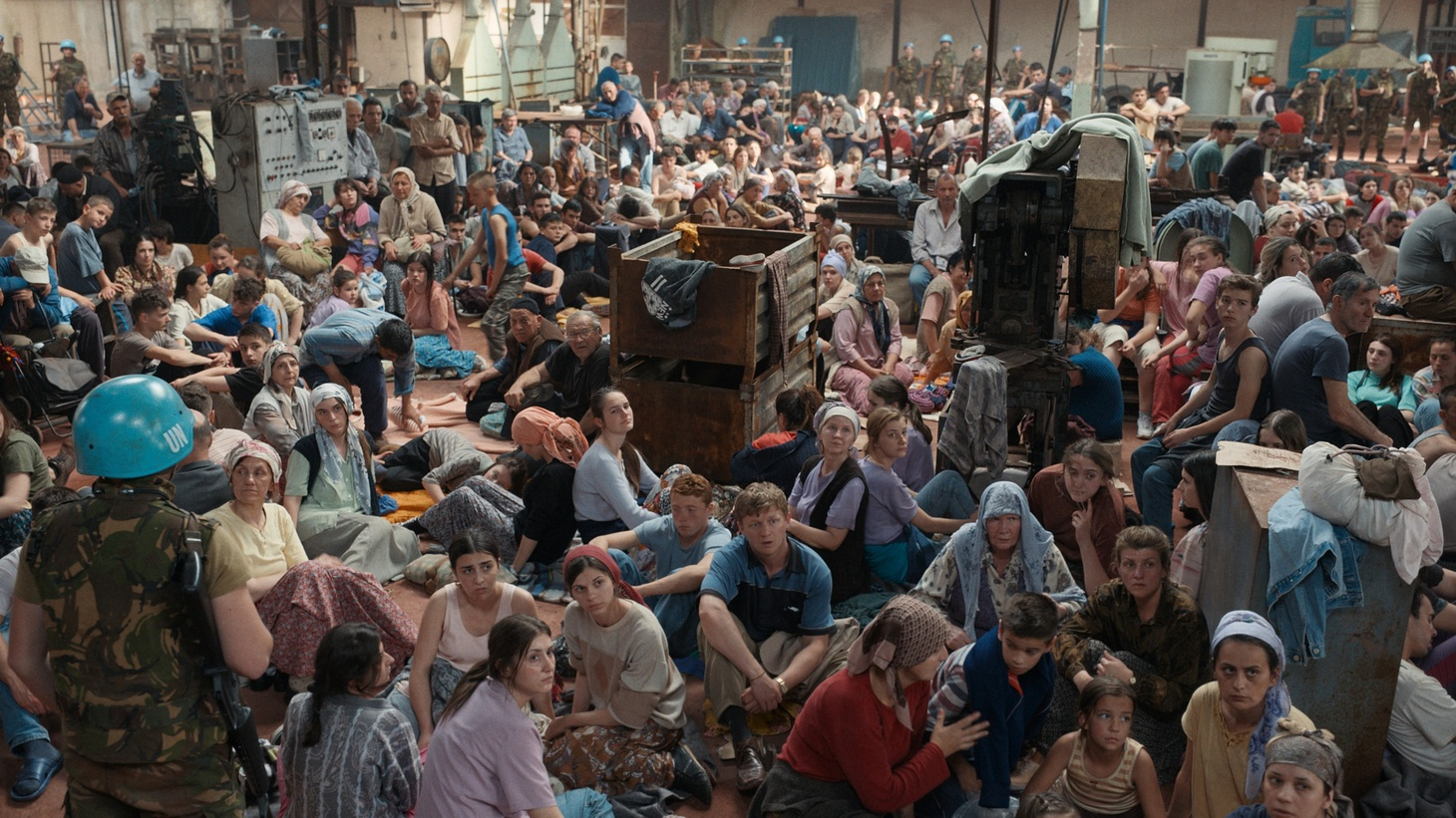 Residents of Srebrenica inside an abandoned factory serving as the UN headquarters, awaiting their fate.