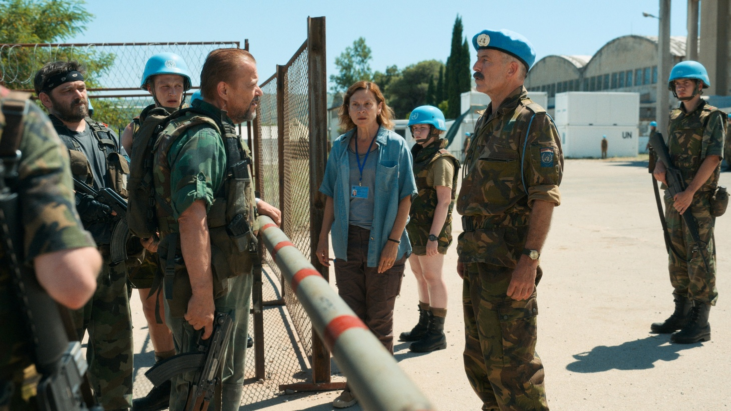 "Aida (actress Jasna Djuricic) and Dutch UN peacekeepers stand off with Bosnian Serb forces at the gate to the UN headquarters in Srebrenica in the film ""Quo Vadis, Aida?"""