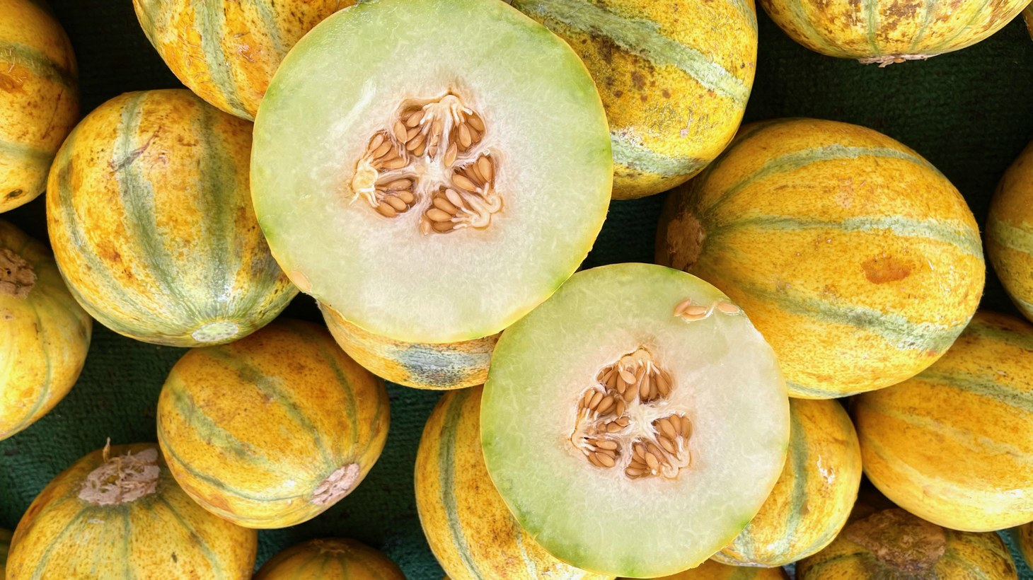 The Ogen melon is originally from Israel, and has yellow and green vertical stripes on its thin rind.