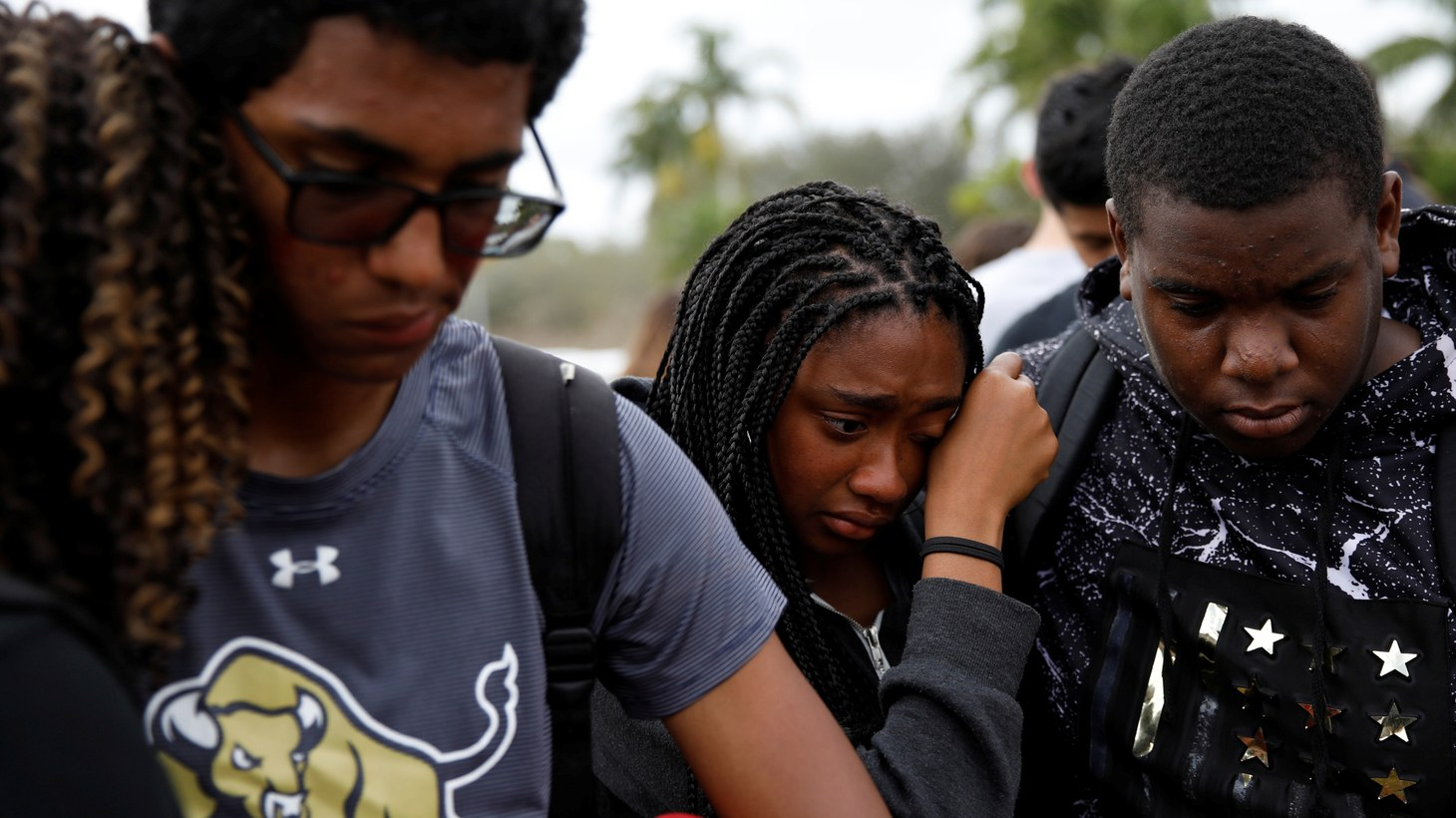 Candace Taylor (C), a student from West Boca Raton Community High School grieves with schoolmates, at Marjory Stoneman Douglas High School, during a protest to show support, following a mass shooting in Parkland, Florida, U.S., February 20th, 2018.