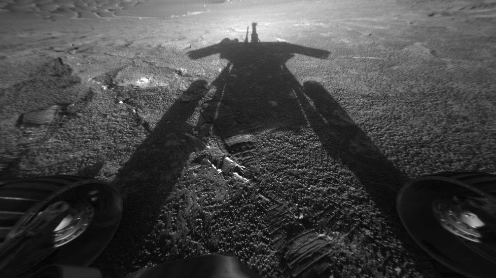 "The Opportunity rover catches its shadow on July 26, 2004, as it continued moving farther into ""Endurance Crater."""