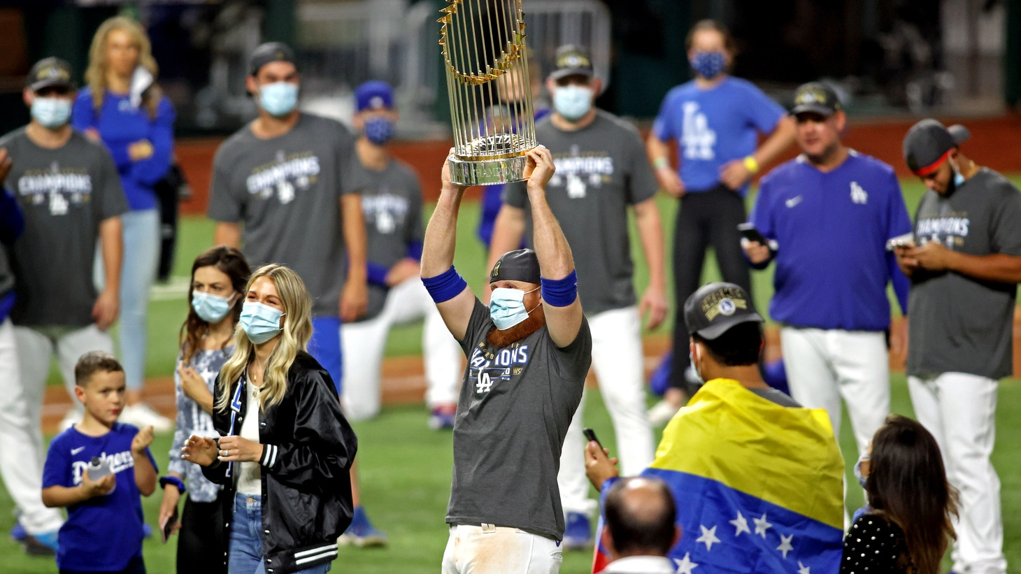 Los Angeles Dodgers third baseman Justin Turner (10) celebrates with the Commissioner's Trophy after the Los Angeles Dodgers beat the Tampa Bay Rays to win the World Series in game six of the 2020 World Series at Globe Life Field. Mandatory