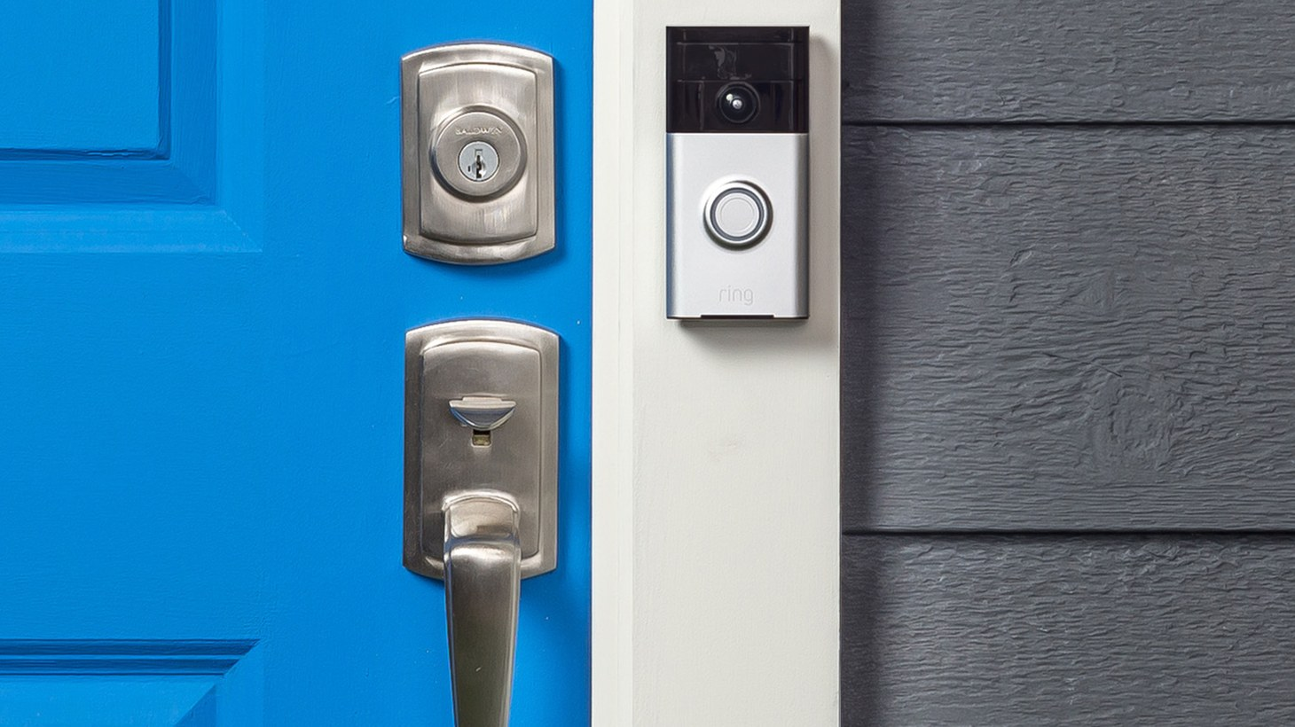 The Ring video doorbell, mounted next to the front door of a house.