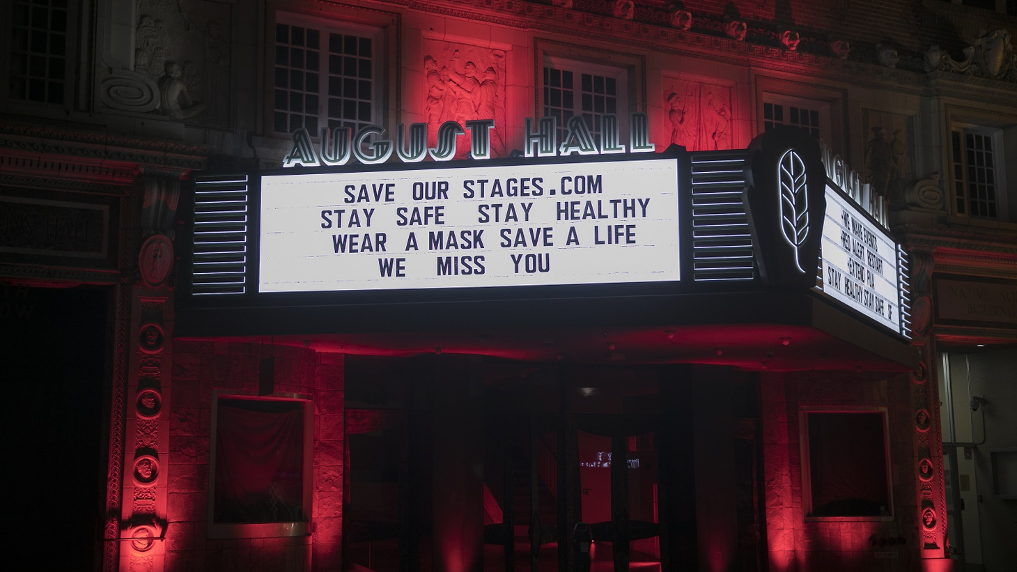 """August Hall in San Francisco displays the sign: """"SaveOurStages.com. Stay safe, stay healthy, wear a mask, save a life, we miss you."""""""