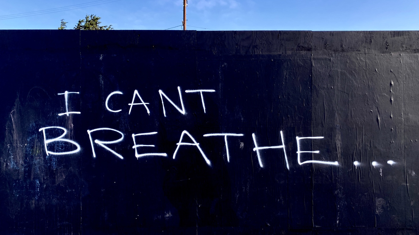 """A wall in Mar Vista, Los Angeles, is spray painted with the words """"I can't breathe,"""" May 30, 2020. Recently, an English teacher at El Camino Real Charter High School in Woodland Hills wore a t-shirt that said """"I can't breathe,"""" then got complaints about it from a father of one of her students. Threats on social media followed."""