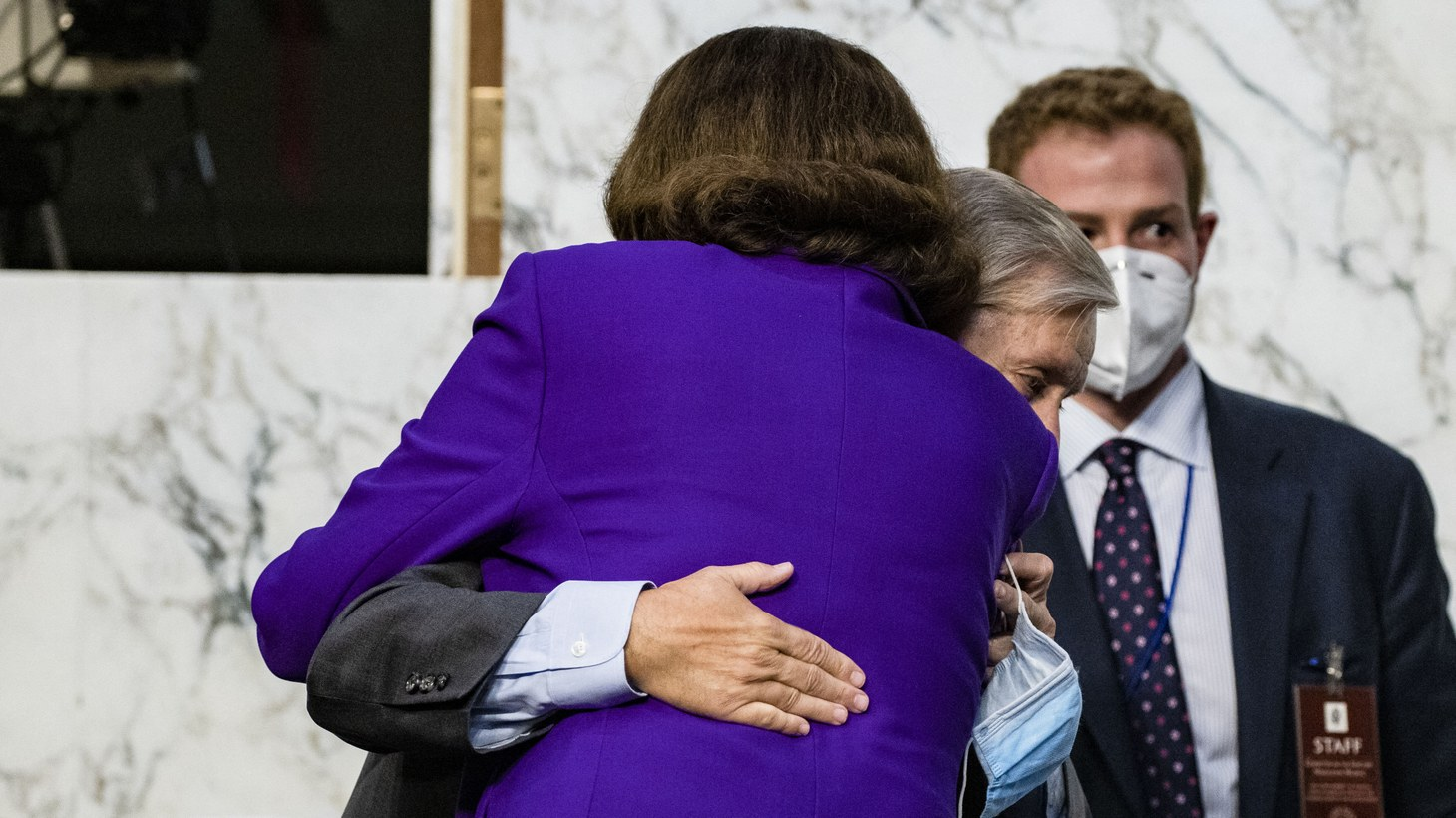 Ranking Member Diane Feinstein (D-CA) (R) and Chairman Lindsey Graham (R-SC) (L) hug as the confirmation hearings for Supreme Court nominee Judge Amy Coney Barrett come to a close on Capitol Hill on October 15, 2020 in Washington, DC, USA. Barrett was nominated by President Donald Trump to fill the vacancy left by Justice Ruth Bader Ginsburg who passed away in September.