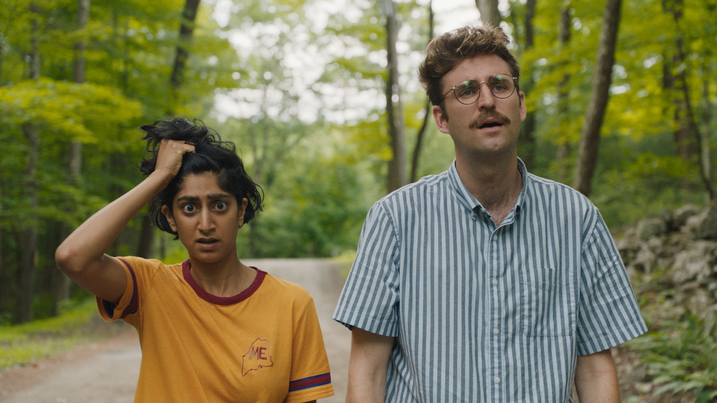 """Sunita Mani (left) stars as Su and John Reynolds (right) stars as Jack in """"Save Yourselves!"""""""