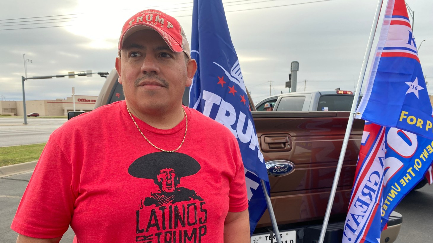 """Ricky Rojas wears a """"Latinos for Trump"""" shirt during a """"Trump Train Rally"""" in San Angelo, Texas, Oct. 24, 2020."""