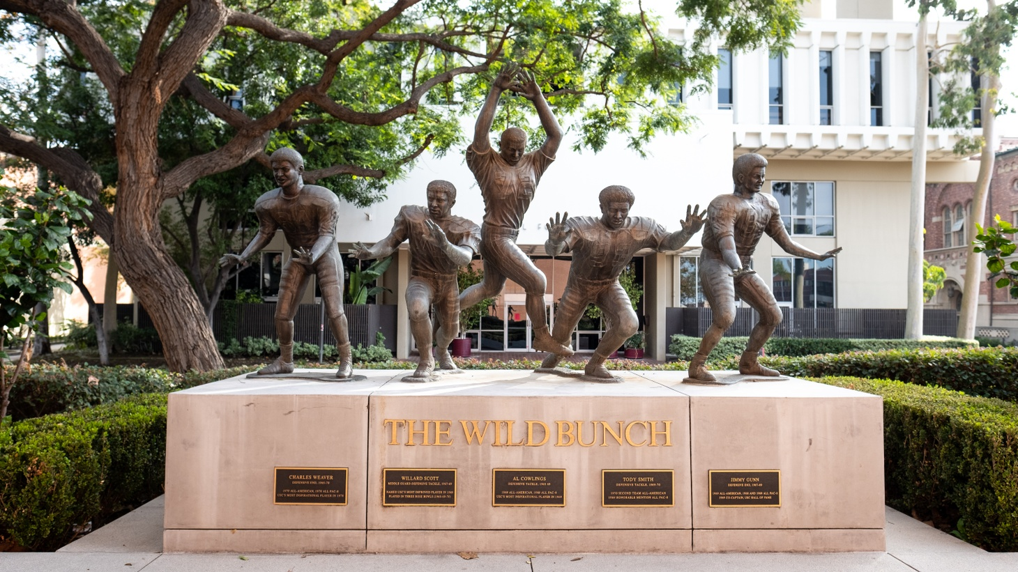 """Statues of the """"Wild Bunch"""" football players are displayed at USC. In a class action lawsuit filed in California, former college football and basketball players argued the NCAA artificially limits their compensation and violates federal antitrust laws by price-fixing the labor market."""