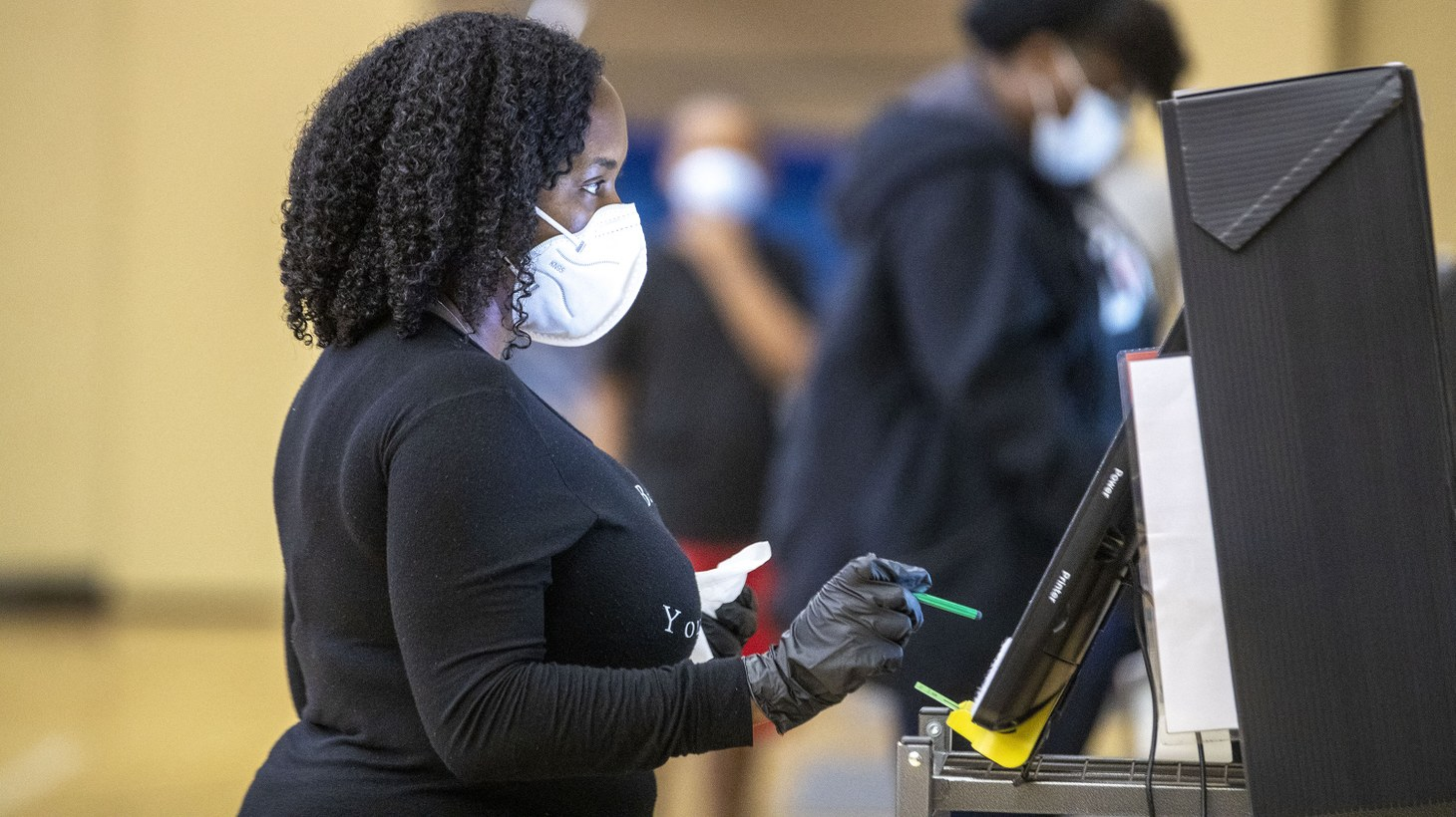 Smyrna resident LaVonya Tensley uses a stylus pen while voting on the new electronic voting machines at the Smyrna Community Center during the Georgia primary elections, Tuesday, June 9, 2020.