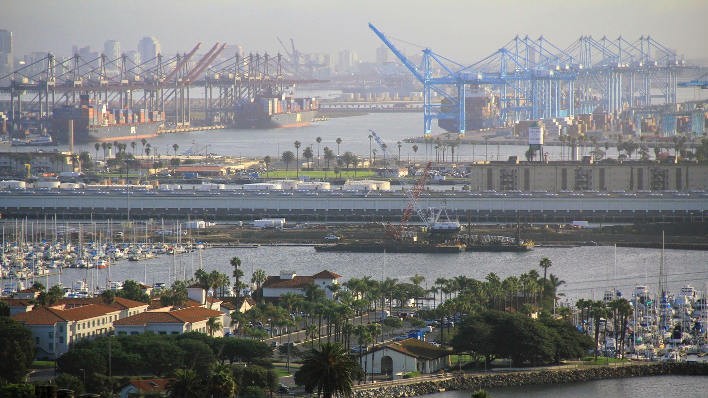 The port of Los Angeles is one of the United States' top gateways for international trade and commerce. But it's backed up now because many dockworkers are off the job due to coronavirus.
