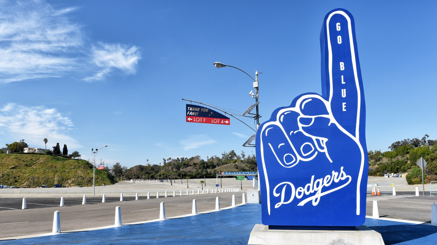 """A number one hand figure with """"go blue"""" sits at Dodger Stadium, February 11, 2020."""